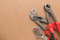 Set of pump plier plier and wrenches tools over a wood panel top view with copy space Stock Photo