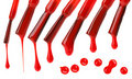 Set of red nail polish brushes and drops Stock Images