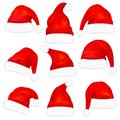 Set of red santa claus hats with fur isolated on white background. Vector Royalty Free Stock Photo