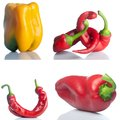 Set of red and yello peppers isolated on white Royalty Free Stock Photos