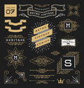 Set of retro vintage graphic design elements sign frame labels ribbons logos symbols crowns corner flourishes line and ornaments Stock Image