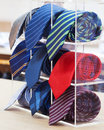 Set of rolled up neck ties on plastic shelf Royalty Free Stock Photography