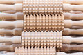 A set of rolling pins with spikes wooden bohemian Royalty Free Stock Image