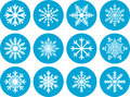 Set of round snowflake icons twelve white or symbols in blue circles Royalty Free Stock Photo