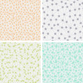 Set of seamless dotted backgrounds four light with dots connected with lines Stock Images
