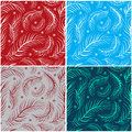Set of seamless patterns with feathers four Stock Images
