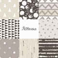 Set of seamless patterns with geometric designs. Circle triangle rhombus stripe in beige gray white. Hand drawn.