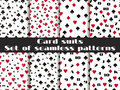 Set of seamless patterns with playing cards suits. Numerals card Royalty Free Stock Photo