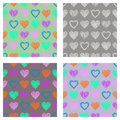 Set of seamless vector patterns with hearts. endless symmetrical backgrounds with hand drawn textured figures. Graphic illustratio