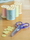 Set of sewing threads and accessories on wooden table Royalty Free Stock Photo