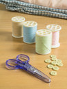 Set of sewing threads and accessories on wooden table Royalty Free Stock Images
