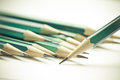 Set of sharpened green pencils on white background Stock Photography