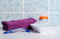 Set of shaving accessories on a white table and tile in the background Royalty Free Stock Images