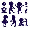 Set of silhouettes halloween element icons. Zombie children in the cemetery. Royalty Free Stock Photo