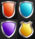 Set of silver framed shields with colors orange blue purple yellow Royalty Free Stock Photos