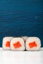 Set of simple japanese rolls with salmon, rice and nori on deep Royalty Free Stock Photo