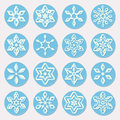 Set of Sixteen Blue Shades Snowflake Ornaments Christmas Design Elements Royalty Free Stock Photo