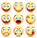 Set of smiley face icons or yellow emoticons with different facial expressions Royalty Free Stock Photo