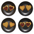 Set of smiley in the form of plates with cookies on white backgroung Royalty Free Stock Photo