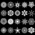 Set of snowflakes silhouettes twenty white on a black background hand drawing vector illustration you can easily change the color Royalty Free Stock Photo