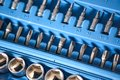 Set of socket wrench and screw drivers in plastic box closeup Royalty Free Stock Photo