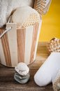 Set of spa accessories in a wooden bucket Royalty Free Stock Photo