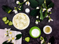 Set of spa treatment products on dark stone background. Flat lay, top view Royalty Free Stock Photo