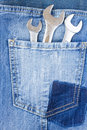 Set of spanners in jeans pocket Royalty Free Stock Photo