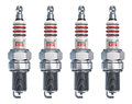 Set of sparkplugs creative car repair service and automotive transportation industry business concept four metal spark plugs Royalty Free Stock Image