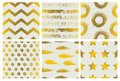 Set of spectacular patterns with gold hand drawn elements on light background. Royalty Free Stock Photo