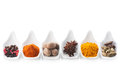 Set of spices in the spoons on a white background Stock Photos