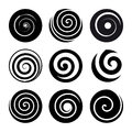 Set of spiral motion elements. Black isolated objects, different brush textures, vector illustrations. Royalty Free Stock Photo