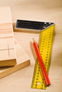 Set-square ruler and pencil with boards Stock Images