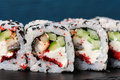 Set of square sushi rolls with vegs, cream cheese and red roe on Royalty Free Stock Photo