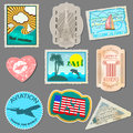 Set of stickers for travelers paper labels sticking to your luggage isolated on gray background Stock Images