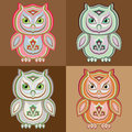 Set of stylized vector colorful owls on brown background Royalty Free Stock Photo