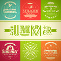 Set of summer vacation and holidays emblems with lettering travel symbols Stock Photos