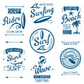 Set surfing labels and emblems on white background Royalty Free Stock Photo