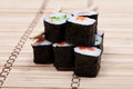 Set sushi with chopsticks on bamboo mat Royalty Free Stock Images