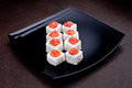Set of sushi maki with caviar on black plate. Japanese food on background Royalty Free Stock Photo
