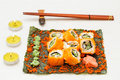 Set of sushi roll on nori with chopstick and candle Royalty Free Stock Image