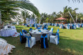 Set table people decorating and furnishing a lawn for a party later in the afternoon at calangute beach candolim goa india Royalty Free Stock Photos
