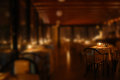Set tables of a restaurant by candlelight Royalty Free Stock Photo