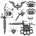 Set of tattoo elements and tattoo machines. Royalty Free Stock Photo
