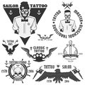 Set of tattoo emblems, elements and tattoo machines. Royalty Free Stock Photo