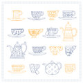 Set of teacups and teapots Royalty Free Stock Photo