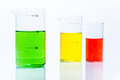 Set of temperature resistant cylindrical beakers with color liquid on white Stock Image