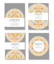 Set templates business cards and invitations with circular patterns of mandalas