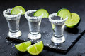 Set for tequila party with lime and salt on black background Royalty Free Stock Photo