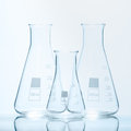 Set of three empty temperature resistant conical flasks for measurements Royalty Free Stock Photo